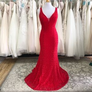 Red lace gown with low back and plunge neckline